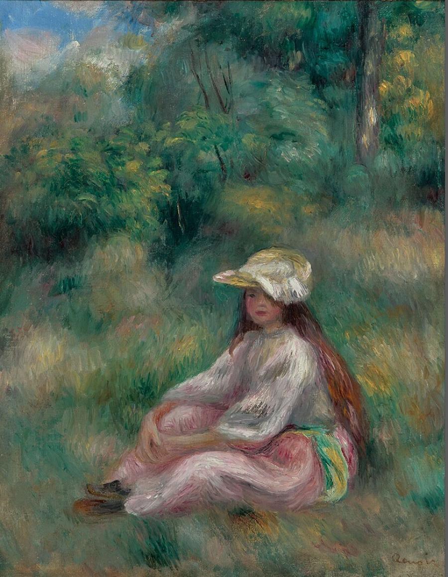 Jeune fille en rose dans un paysage