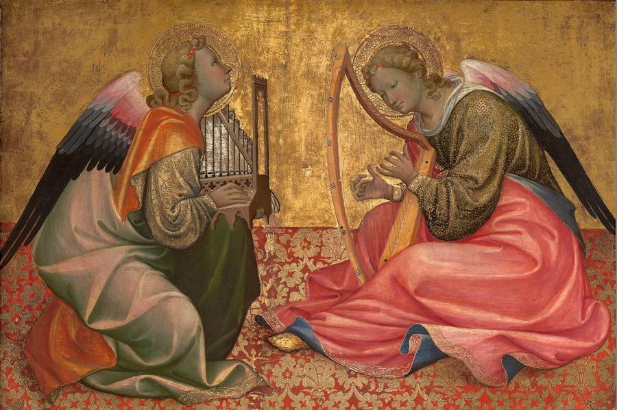 Twee op de grond zittende, musicerende engelen