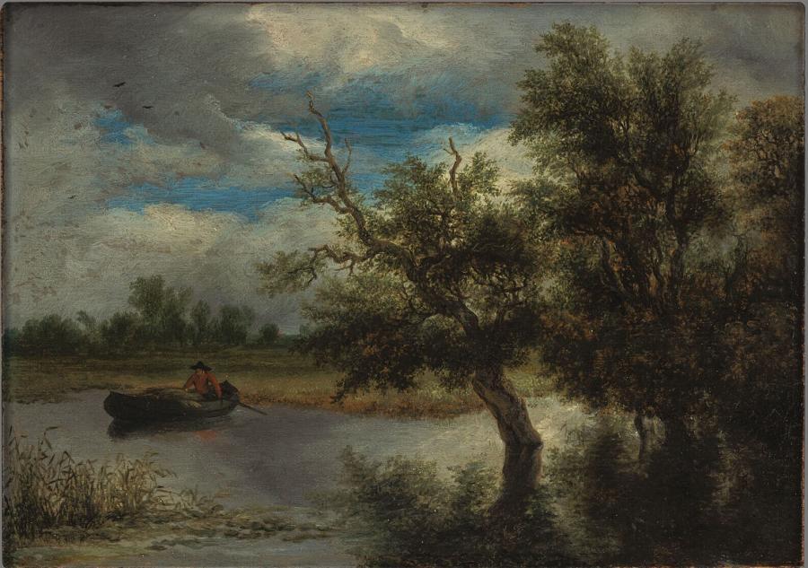 Bomen aan een plas met roeiboot