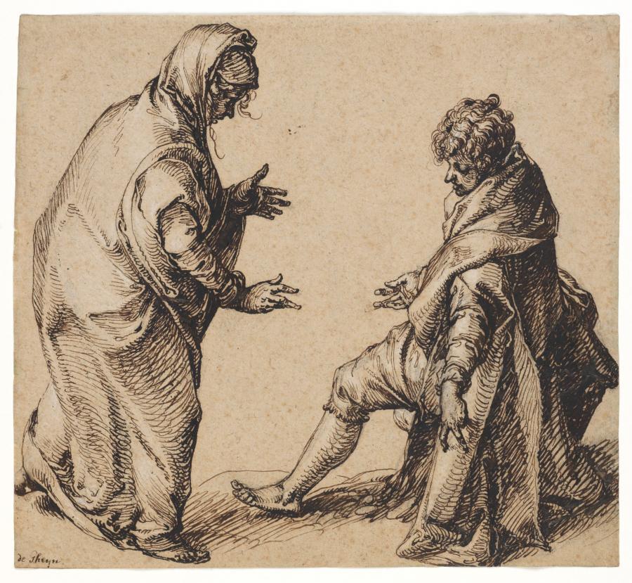Een staande vrouw en een zittende man