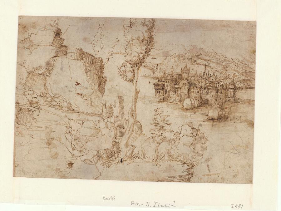 Rotslandschap met heuvels en een stad aan een meer