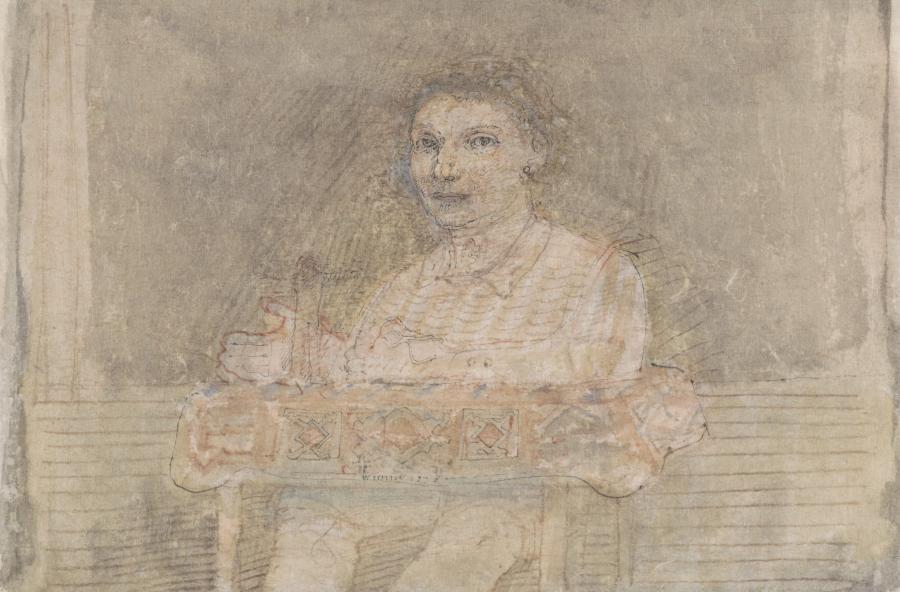 Oudere dame met herinnering aan tafel