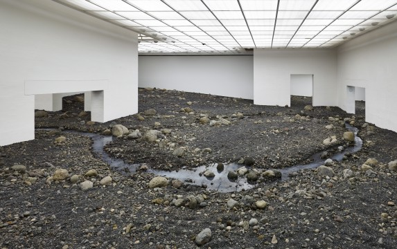 Riverbed, 2014. Water, blue basalt, wood, steel, foil, hose, pumps, cooling unit. Louisiana Museum of Modern Art, Humlebaek, Denmark, 2014 Photo: Anders Sune Berg.